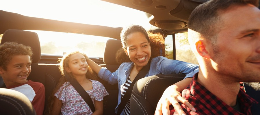 CHAM-Family-Riding-In-Car