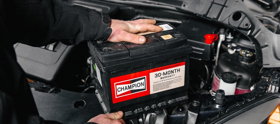 CHAM-Mechanic-Installing-Car-Battery