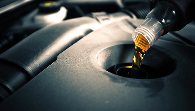 Oil-Being-Added-To-Car-Engine